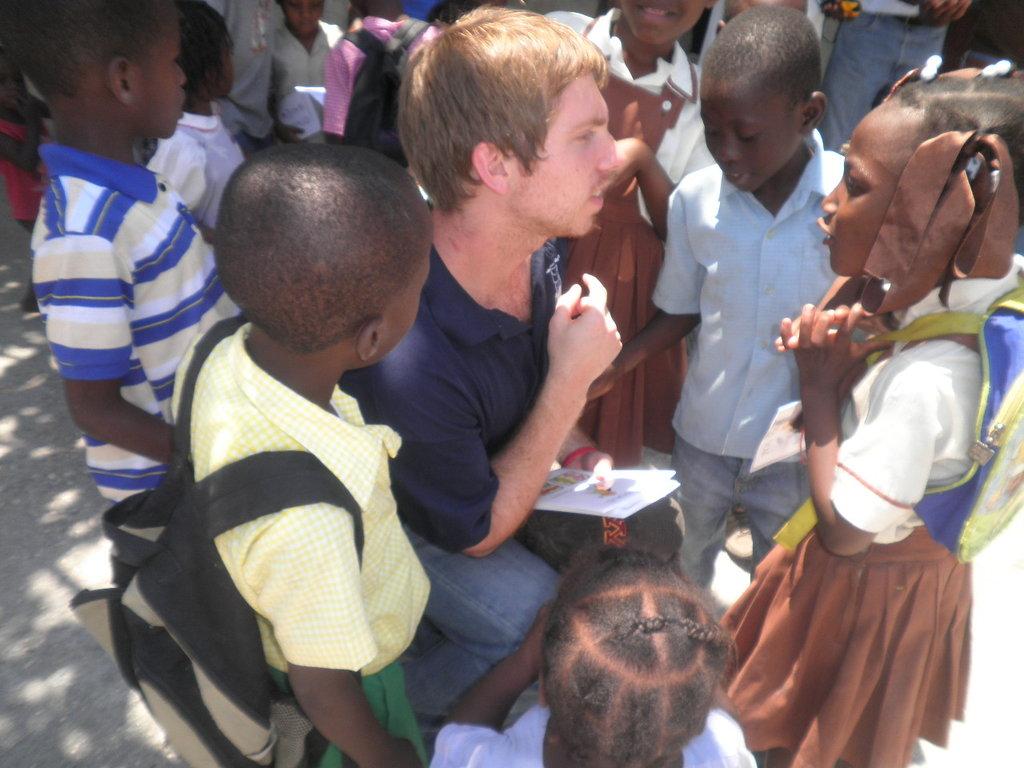 Children receiving books at Ecole Freres Joseph
