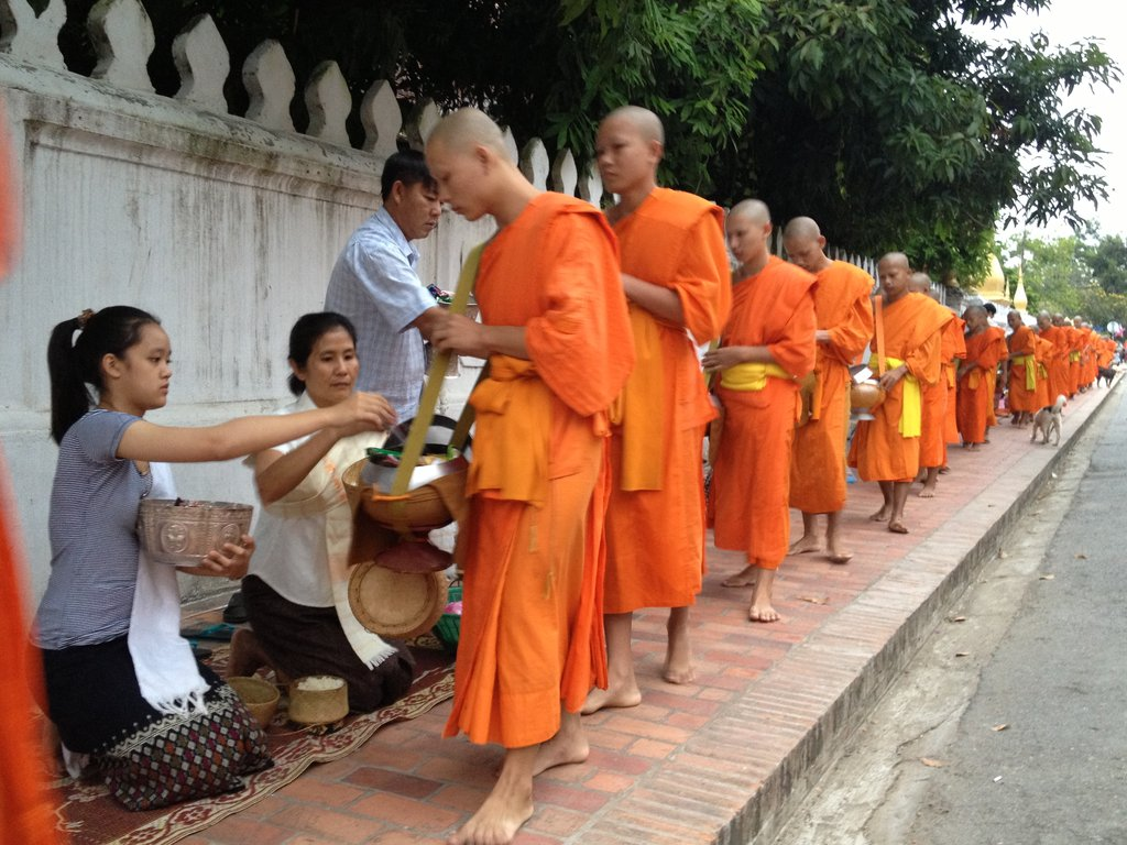 Learning about Laos Buddism Culture of Alms Giving