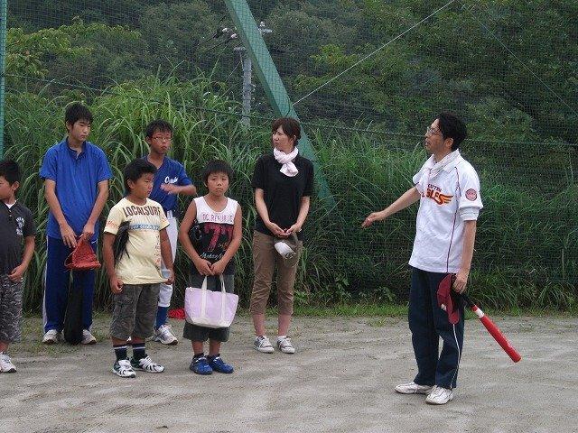 Students and parents play baseball