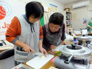 Participants carefully cut vegetables