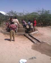 Children fetching water from a rehabilitated well