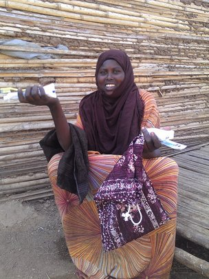 Fadumo holding some of her  hygiene items