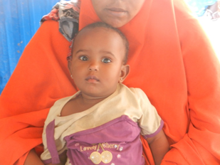 Ikhlaas with her mother