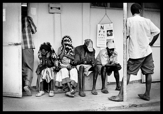 Patients wait to be screened