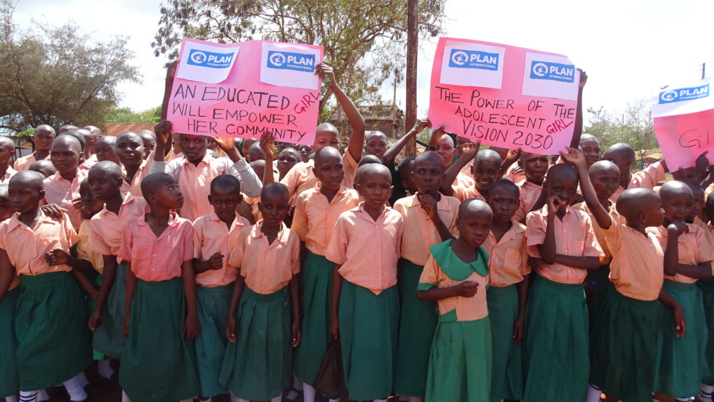 Girls raise their voices in a peaceful procession