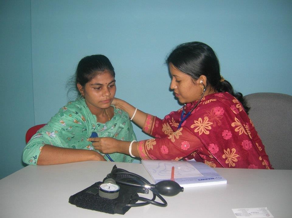 Dr. Sima Rani Mazumder, MBBS treating a patient