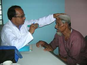 A Doctor from BJAKS examining an elderly patient