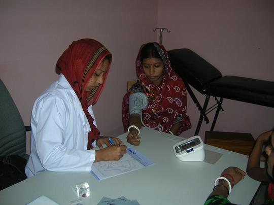 Dr. Dilrupa Akther checking a patient.