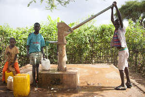 Children collect clean water for their households