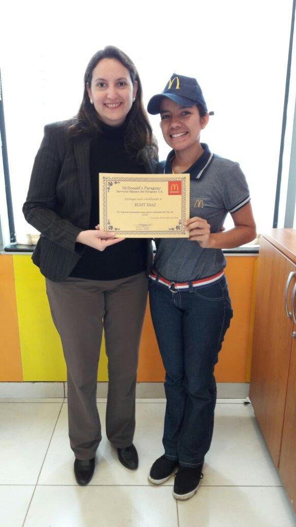 Ruth receiving her best employee certificate