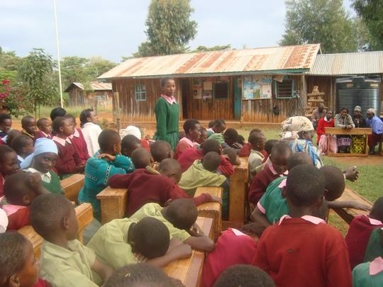 Rosemary Nyambura(Standing) addressing the school
