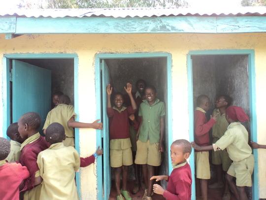Children celebrate the new latrines. GHARP/KRA
