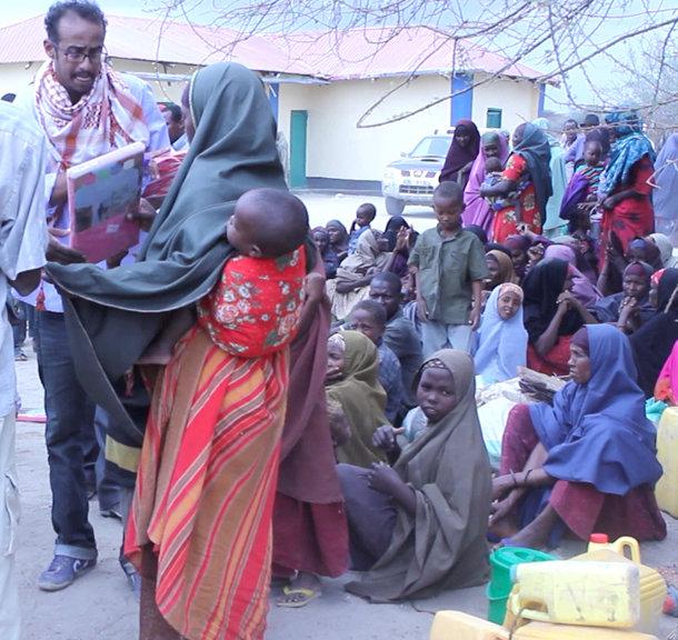 Abdisalaan Aato delivering supplies