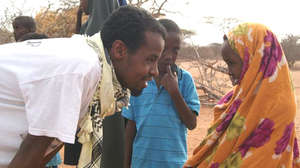 Ayub talks with young girl at Daffur, Kenya