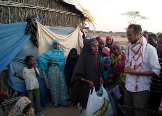 Abdisalaan with Somali refugees Liboi, Kenya