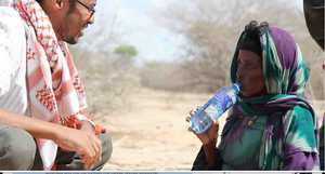 Aato & refugee, walked 22 km, 90 km more to Dadaab