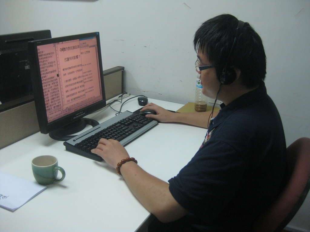 A member of staff recording a DAISY book