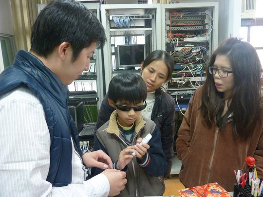 visually impaired student using DAISY player
