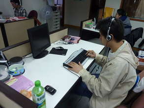 visually impaired colleague is operating computer