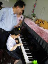Visit to Huei-Ming School for Blind Children