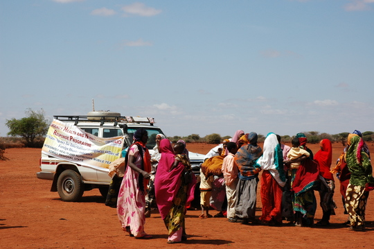 Mothers bring children to mobile health clinics