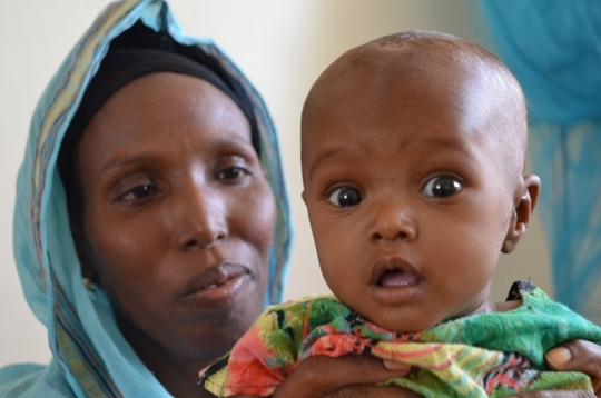 Baby Hawa Mumin held by her aunt Nima Hassan