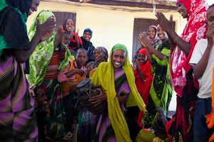 Women celebrating at the milk collection center