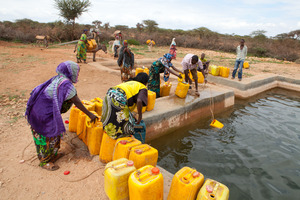 Women collect water from the reservoir