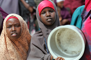 Girls in Somalia wait for food distribution