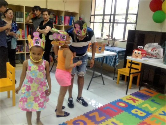 Children enjoying toy party