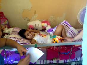 Child in chemotherapy resting with toys