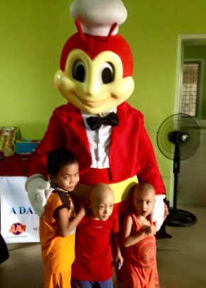 Child undergoing cancer treatment hugs Jolibee