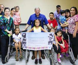 Pauline, holding banner & AAI Dir. Santoli at PSOD