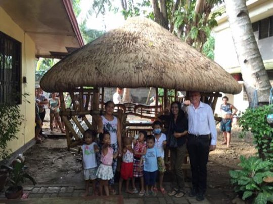 Families stay in bamboo huts outside House of Hope