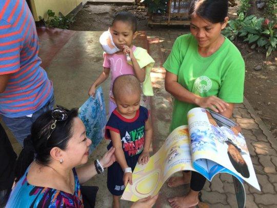 Fun reading Big Books with AAI and OWI volunteers