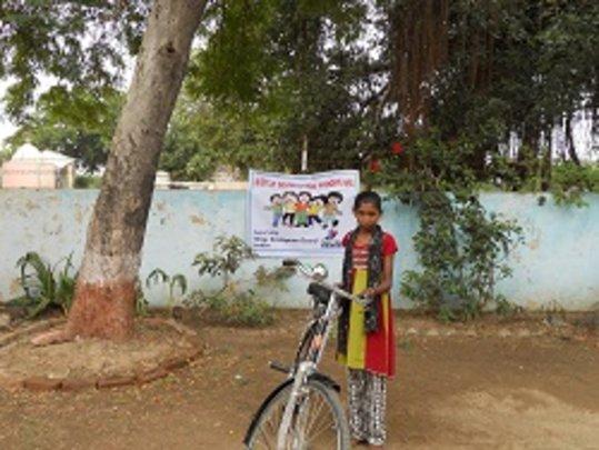 Vinita riding bicycle