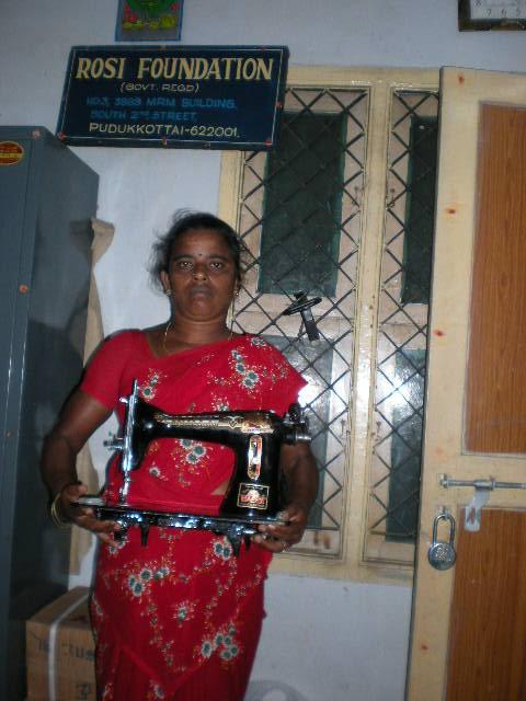 Ms.Sarathambal receives sewing machine