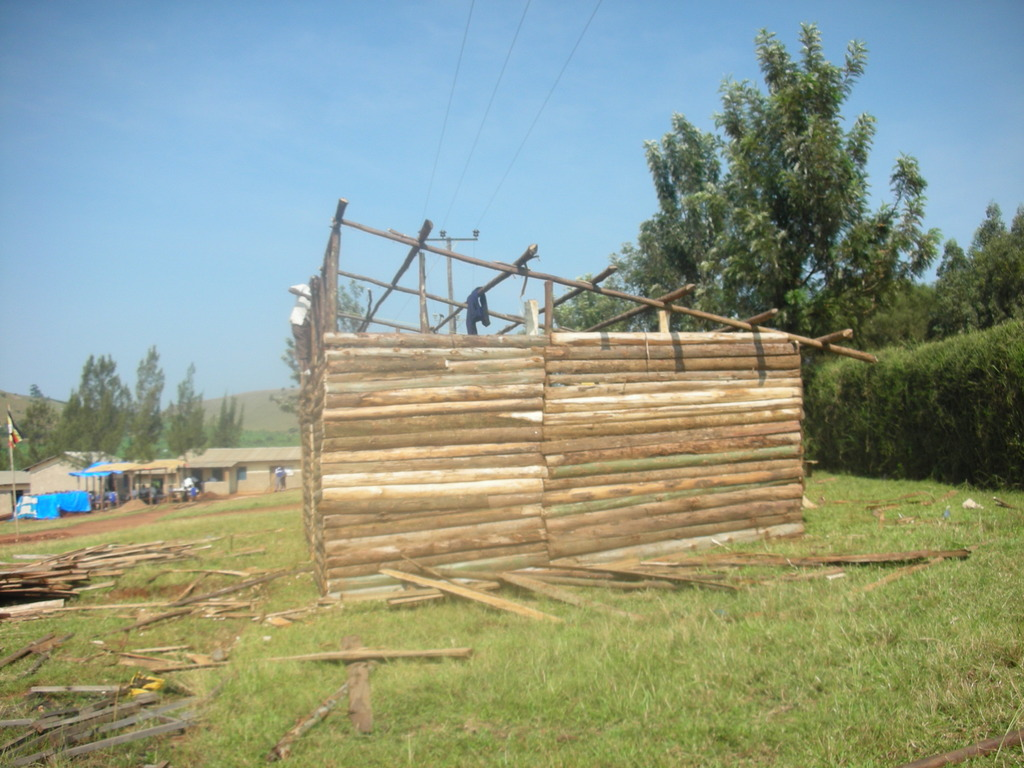 The students help build the shelter.