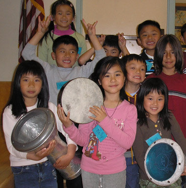 Having fun in drum class! Students in San Francisco pose with drums they learned to play in music class.