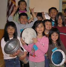 Children with hand drums