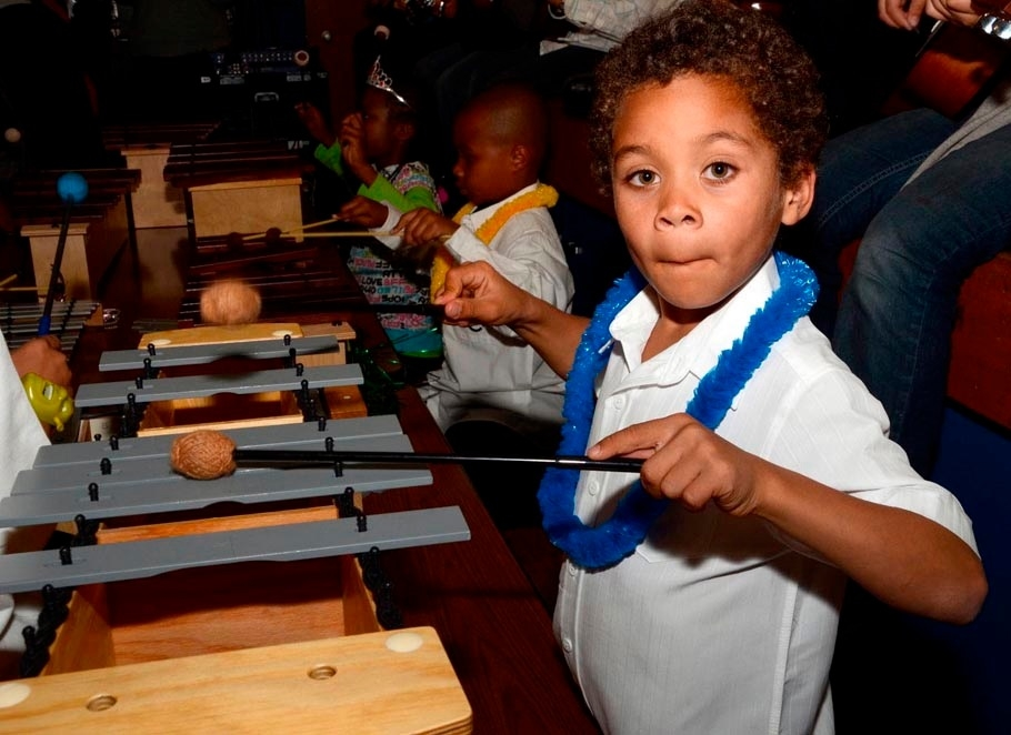 Play that xylophone! A young Orff student demonstrates his skills during a performance in San Leandro.
