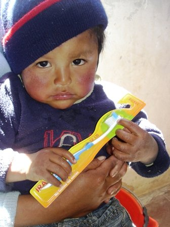 Child in Jujuy receiving his tooth brush