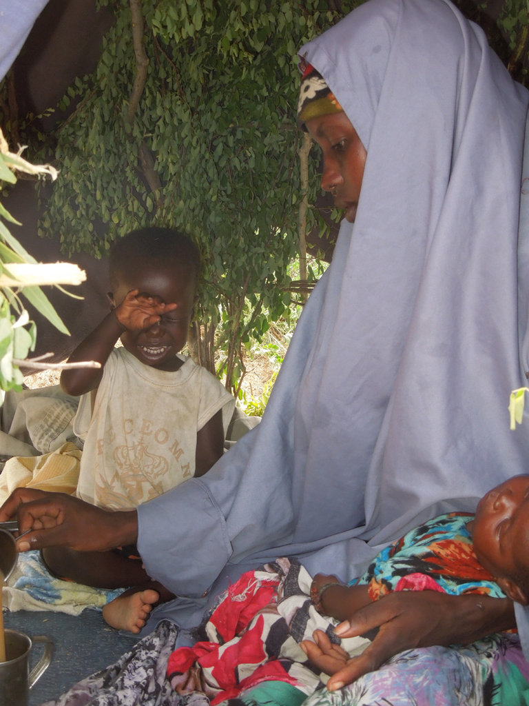 Maria Abdi with two of her children in Dhobley.