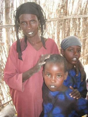 Marium Dahir and two of her children.
