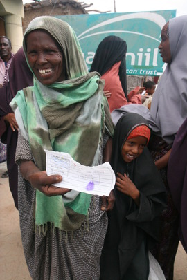 An excited family receives a voucher for food.