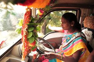 Savita driving her school van