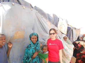 Amy and a family in the refugee camp