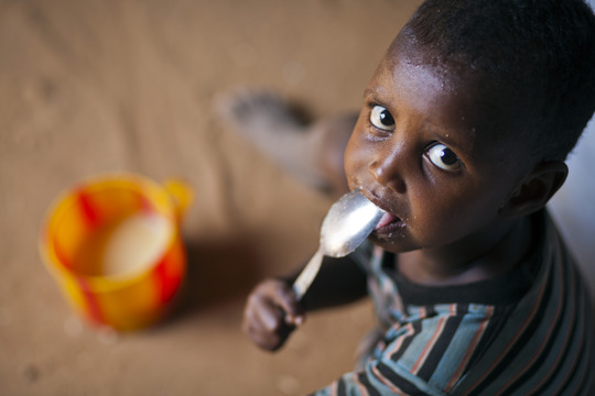 Refugee boy from Somalia receives a meal