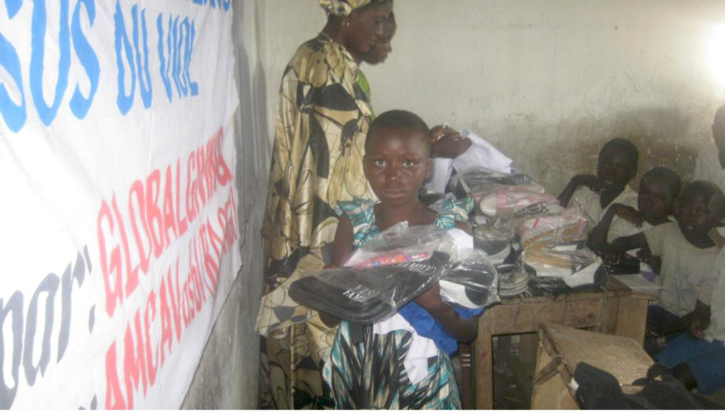 A girl receives items in Kiliba