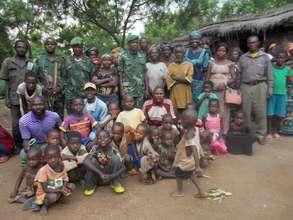 The Rwenena school community with military escort